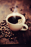Steaming cup of freshly brewed coffee. Shallow depth of field Royalty Free Stock Images
