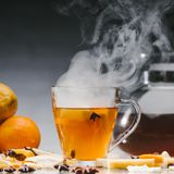 Steaming cup of hot black tea Royalty Free Stock Images