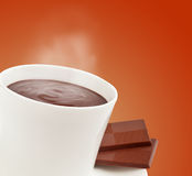 Steaming cup of hot chocolate. Steaming hot chocolate with two squares of luxurious european dark chocolate Stock Photography