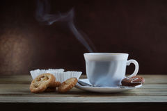Steaming Cup Of Hot Coffee And Biscuits Stock Image