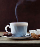 Steaming Cup Of Hot Coffee And Cookies Stock Photography