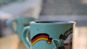 Steaming Cup of Hot Mulled Gluehwein at German Market in British Town Stock Images