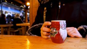Steaming Cup of Hot Mulled Gluehwein at German Market in British Town Stock Photo