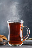 Steaming cup of tea, still life on a dark background Stock Image