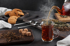 Steaming cup of tea, still life on a dark background Stock Images