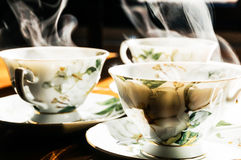 Steaming cups of coffee Stock Photos