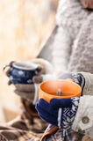 Steaming cups of tea winter hands holding Royalty Free Stock Photo