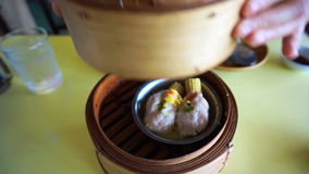 Steaming Dim Sum open different layers traditional Chinese food stock video