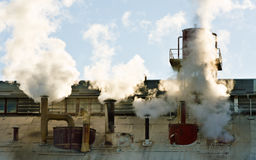 Steaming factory chimneys Royalty Free Stock Photos