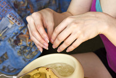 Steaming fingers in the bath before the manicure Royalty Free Stock Images