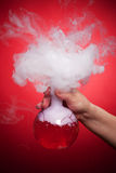 Steaming flask with red liquid Stock Photography