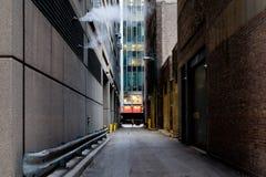 Narrow back alley in Chicago concrete jungles stock photos