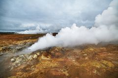 Steaming geysers in a beautifil Iceland landscape. Royalty Free Stock Photo