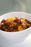 Steaming hot Chili con carne. White porcelain bowl with chili con carne, plate stock photos