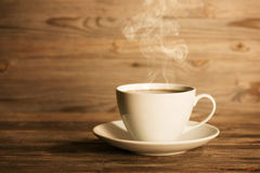Steaming hot coffee in white mug Stock Photography