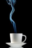 Steaming hot cup of coffee. Steaming hot cup of tea or coffee, reflecting on black background stock photos