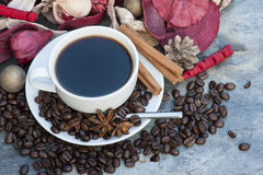 Steaming hot cup of coffee on Christmas background Royalty Free Stock Photo