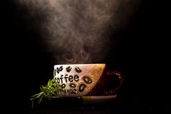 Steaming hot cup of coffee Royalty Free Stock Image