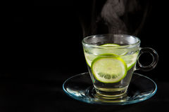Steaming hot lemon water. Isolated on black background royalty free stock image
