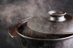 Steaming iron pot. Cover opened stock photography