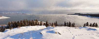 Steaming Lake Laberge Yukon pano before freezing Royalty Free Stock Photo