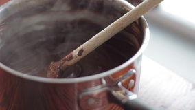 Steaming melted chocolate with wooden spoon stock video footage