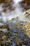 Steaming mud holes, Seltun, Iceland. The alien landscape and rocky coloured mineral deposits of steaming , Seltun, Iceland Stock Image