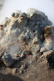 Steaming Mud Pots in the Namaskard geothermal area royalty free stock photo