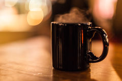 Steaming mug Stock Images