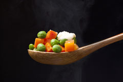 Steaming peas and carrots. Royalty Free Stock Photo