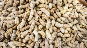 Steaming pile of peanuts in a wooden tray weave. Steaming pile of peanuts in a wooden tray weave, Thailand Food street - soft focus Royalty Free Stock Photos