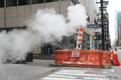 Steaming pipe in Midtown Manhattan Stock Images