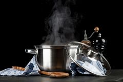 Steaming pot on black background Stock Image