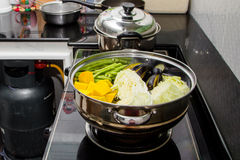Steaming pot. Pumpkin, cabbage, beans, eggplant in steaming pot stock image