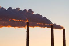 A steaming power plant pipes Royalty Free Stock Photography