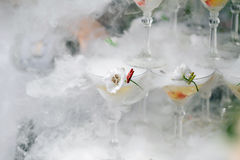 Steaming pyramid of glasses for champagne. At outdoor garden in wedding ceremony Stock Image