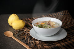 Steaming rice soup Stock Images