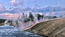 Steaming River of Yellowstone at sunset. Royalty Free Stock Images