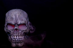 Steaming skull. A Halloween prop skull with fog coming from it's eyes and nose Royalty Free Stock Photos