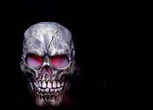 Steaming skull. A Halloween prop skull with fog coming from it's eyes and nose Stock Image