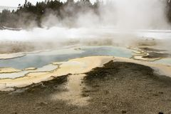 Steaming spring rock formation in Upper Geyser Basin, Yellowston Stock Photos