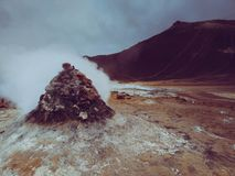 Steaming sulphur fumaroles at geothermal area Hverir in north Iceland royalty free stock images