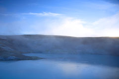 Steaming sulphur pool. Steaming milky blue sulphur pool at dusk Iceland Stock Photography