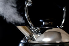 Steaming tea kettle Stock Photos