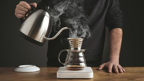 Steaming v60 drip coffee pot stock video footage