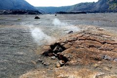 Steaming vents on the Kilauea Iki volcano crater surface with crumbling lava rocks in Volcanoes National Park in Big Island of Haw. Aii, USA Royalty Free Stock Photography