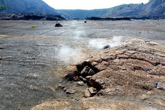 Steaming vents on the Kilauea Iki volcano crater surface with crumbling lava rocks in Volcanoes National Park in Big Island of Haw Stock Photo