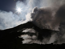 Steaming Volcano etna in Sicily in the morning sun. Volcano etna in Sicily with steam emission in the morning sun Royalty Free Stock Photography