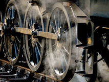 Steaming wheels Stock Photo