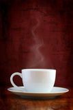 Steaming white cup Royalty Free Stock Images